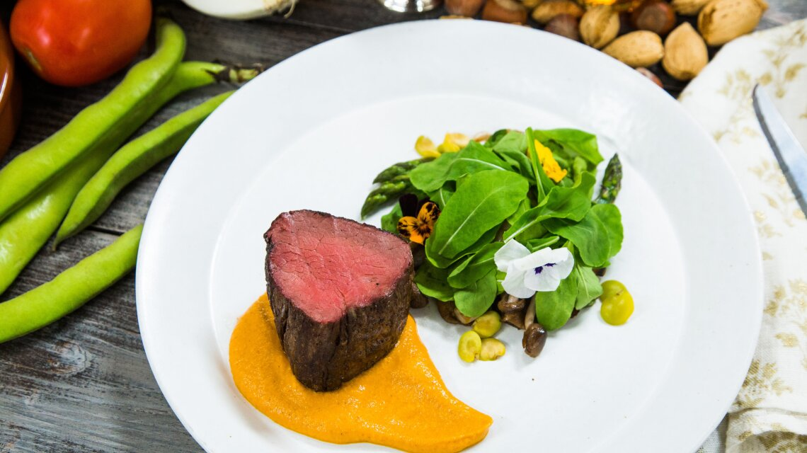Roasted Beef Tenderloin with Vegetables and Romesco Sauce