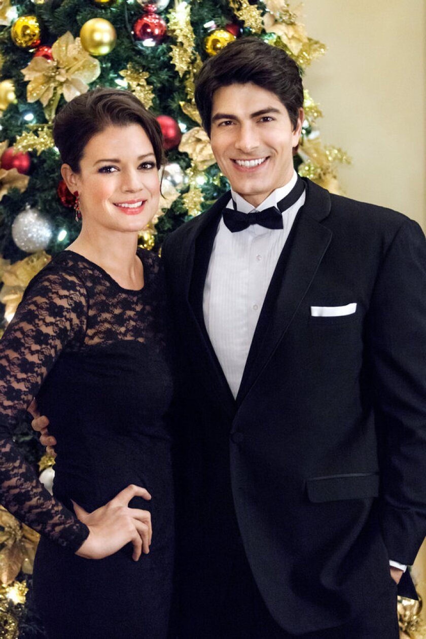THE NINE LIVES OF CHRISTMAS -With Christmas approaching, a handsome fireman afraid of commitment adopts a stray cat and meets a beautiful veterinary student who challenges his decision to remain a confirmed bachelor.  Photo (Left to right): Kimberley Sustad, Brandon Routh Photo Credit: Copyright 2014 Crown Media United States, LLC/Photographer:David Owen Strongman
