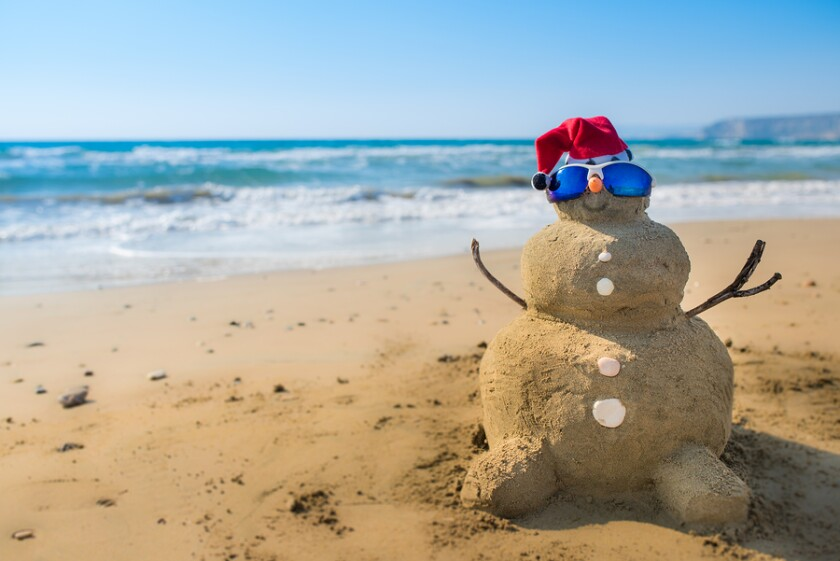 bigstock-Holidays-Snowman-made-of-sand-111785180.jpg