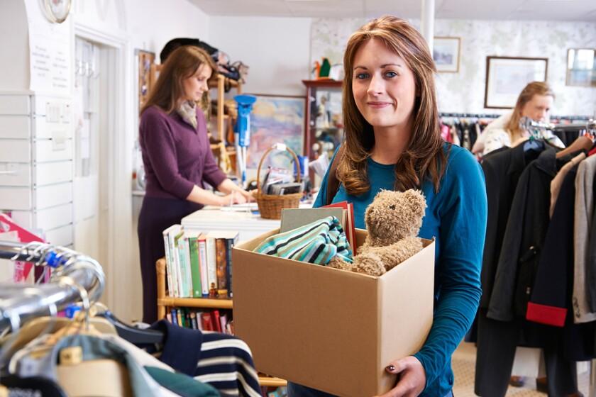 bigstock-Woman-Donating-Unwanted-Items--109211564.jpg