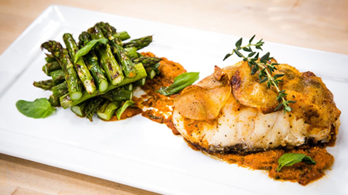 Cristina Ferrare's Potato Fanned Striped Bass With Red Pepper Pesto, Roasted Asparagus And Shaved Parmesan