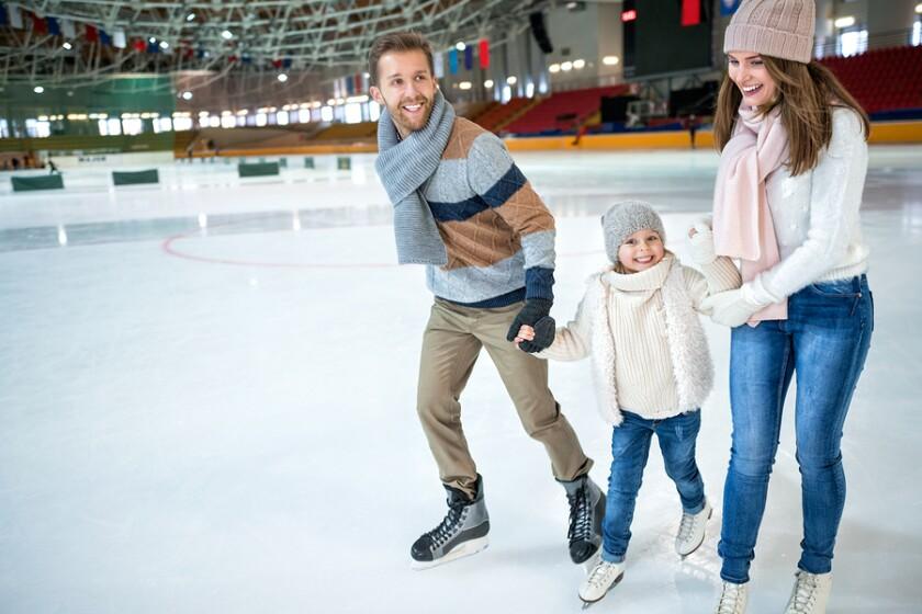 bigstock-Smiling-family-at-ice-skating--130959635.jpg
