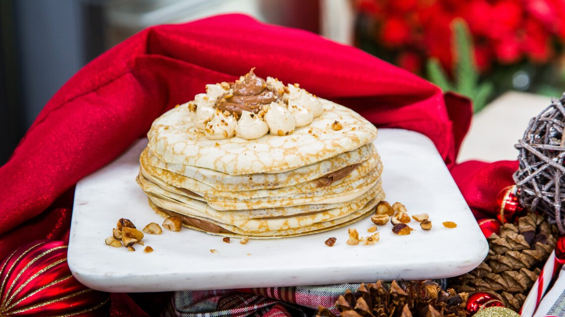 Buckeye Crepe Cake with Peanut Butter, Nutella, Whipped Cream and Hazelnuts