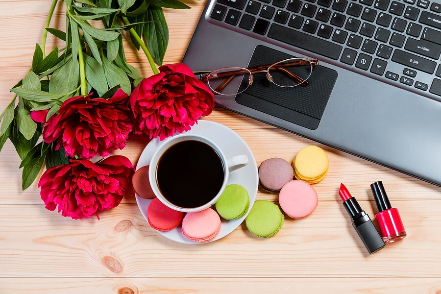 Desk With Laptop, Peony Flowers, Lipstick And Cup Of Coffee. Top